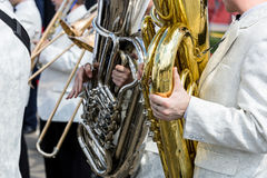 Orchestra musicians playing tubas and trombones during music fes Stock Images