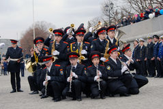 Orchestra musicians - trumpeters and flute players. MOSCOW - APRIL 22, 2016: Orchestra musicians - teenage boys, trumpeters and flute players - play music on stock images
