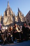 An orchestra outside the Cathedral Santa Eulalia. Royalty Free Stock Image