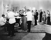 Orchestra playing and couples dancing. (All persons depicted are no longer living and no estate exists. Supplier grants that there will be no model release Royalty Free Stock Images