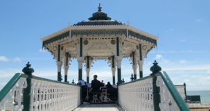 Orchestra playing music on the bandstand in Brighton and Hove stock video