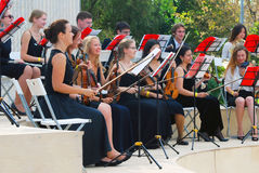 Orchestra plays in the Gorky park in Moscow. Royalty Free Stock Images