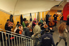 The orchestra plays on the metro station in Paris Stock Photography