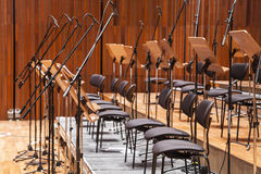 Orchestra stage with chairs and microphone in row Royalty Free Stock Photo