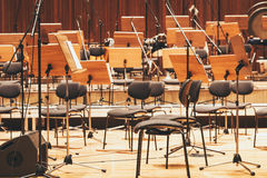 Orchestra stage with chairs and microphone Stock Photo