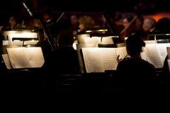 Orchestra symphony dark stock photos