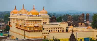 Orchha cityscape, kitsch yellow Ram Raja temple. Also spelled Orcha, famous travel destination in Madhya Pradesh, India. Orchha cityscape, kitsch yellow Ram Royalty Free Stock Photography