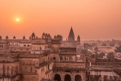 Orchha Palace, hindu temple, cityscape at sunset, Madhya Pradesh. Also spelled Orcha, famous travel destination in India. Orchha Palace, hindu temple, cityscape Stock Photo