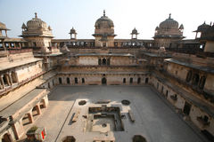 Orchha Palace india. Orchha (or Urchha) is a town in Tikamgarh district of Madhya Pradesh state, India. The town was the seat of an eponymous former princely Stock Photography