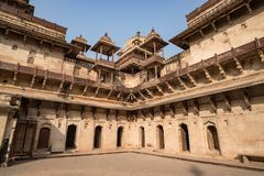 Orchha Palace, interior with courtyard and stone carvings, backlight. Also spelled Orcha, famous travel destination in Madhya Prad. Esh, India Stock Image