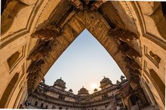 Orchha Palace, interior with courtyard and stone carvings, backlight. Also spelled Orcha, famous travel destination in Madhya Prad. Esh, India. Ultra wide fish Royalty Free Stock Photos