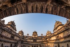 Orchha Palace, interior with courtyard and stone carvings, backlight. Also spelled Orcha, famous travel destination in Madhya Prad. Esh, India. Ultra wide fish Royalty Free Stock Photography