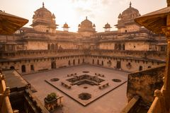 Orchha Palace, interior with courtyard and stone carvings, backlight. Also spelled Orcha, famous travel destination in Madhya Prad. Esh, India Stock Photo