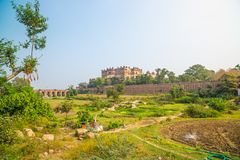 Orchha Palace, sunny day and blue sky, green landscape and cultivated fields around. Also spelled Orcha, famous travel destination. In India Royalty Free Stock Images