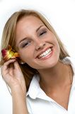 Orchid. Pretty blond woman with flower orchid royalty free stock image