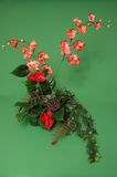 Orchid Arrangement. A flower arrangement made out of orchids and greenery Stock Image