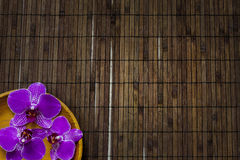 Orchid on bamboo mat spa cosmetic abstract background Stock Photography