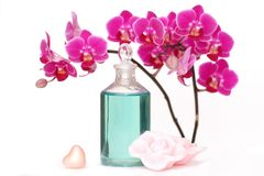 Orchid beauty. A beauty set with massage oil as well as rose petal and heart shaped soap Royalty Free Stock Image