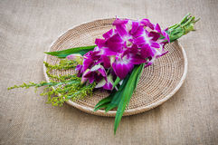 Orchid Bouquet in placemat on sackcloth Royalty Free Stock Images