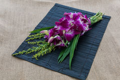 Orchid Bouquet in placemat on sackcloth Royalty Free Stock Photography