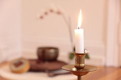 Orchid candle and decoration Royalty Free Stock Images