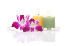 Orchid, Candle and Pebble Stock Photo