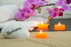 Orchid, candle and sand. Orchid, candles, sand and towel still life Royalty Free Stock Photos