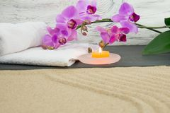 Orchid, candle and sand Stock Photo
