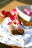 Orchid and candles for spa setting Royalty Free Stock Photo