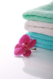 Orchid and colour towels Royalty Free Stock Photography