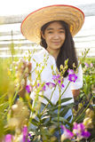 Orchid farm girl Royalty Free Stock Image