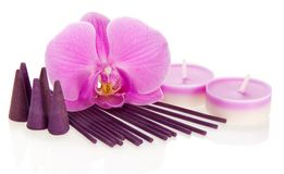 Orchid flower, aromatic sticks and cones, candles Royalty Free Stock Photo