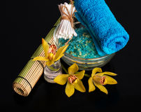 Orchid flower, sea salt and object for spa procedures Royalty Free Stock Image