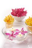 Orchid head and candle Stock Photo