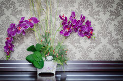 Orchid. Purple orchids in vase on table as interior decoration royalty free stock images