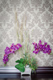 Orchid. Purple orchids in vase on table as interior decoration royalty free stock photo