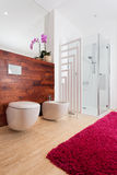 Orchid and red carpet in bathroom Stock Photo