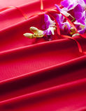 Orchid on red satin Stock Photo