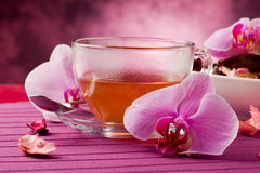 Orchid Tea. Photo of orchid tea inside a glass cup with big orchid flower Royalty Free Stock Image