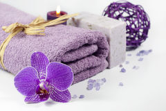 Orchid and towel spa concept with bath salt Royalty Free Stock Image