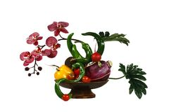 Orchid and vegetables. Flower arrangement in a vase with an orchid and vegetables Stock Photography