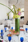 Orchid at the white party. Tables set for a birthday party with hors d'oeuvres at a Hotel in Hollywood Fl Stock Image