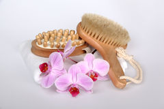 Orchid with a white towel and brush. Pink stripy phalaenopsis orchid with a white towel and brush Stock Photos