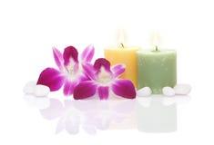Orchidea, candela e ciottolo Fotografia Stock