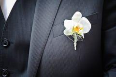 Orchidea sul vestito Immagine Stock