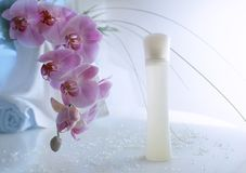 Orchids Aroma. White flacon of perfume with tender orchids Royalty Free Stock Image