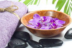 Orchids in the bowl with towel spa cosmetic concept Stock Photo