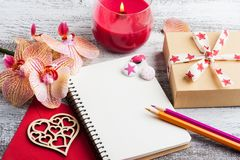 Orchids, empty notebook and craft gift box stock photo