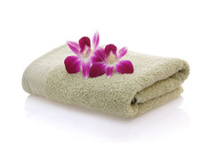 Orchids on Green Towel Royalty Free Stock Photos
