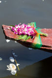 Orchids on an old wooden boat in Thailand Royalty Free Stock Photos